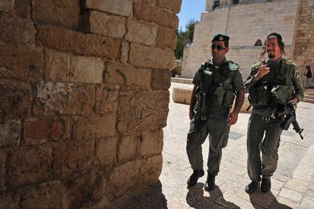 synagogues: JERUSALEM - JULY 28:Israeli soldiers guards the Jewish Quarter on July 28 2009 Jerusalem,Israel.The quarter is inhabited by around 2,000 residents and is home to numerous yeshivas and synagogues.