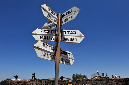street signs: GOLAN HEIGHTS - AUG 23:Israelis visit on Mount Bental on August 23 2009 in the Golan Heights, Israel.Israel captured it in 1967 war and annexed it in 1981 in a move not recognized internationally. Editorial