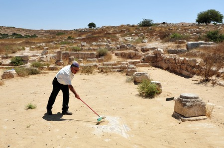 judaean: AMATZIA, ISR - AUG 02:Archaeologist expose a Mosaic at Amatzia Caves near Kiryat Gat on August 02 2009.During troubled times, the Jews of ancient Israel often dwelled in artificial limestone underground caves.