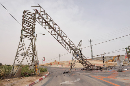 gat: KIRYAT GAT, ISR - MAY 04:Toppled overhead power line on April 04 2009. High voltage transmission and distribution lines carry a lot of energy or power and if not treated with respect can be fatal.