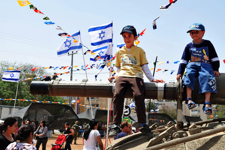 judaica: SDEROT - APRIL 29:Israeli Children are enjoying Israels Independence day celebrations and are playing with tanks and armed vehicles on April 29 2010 in Sderot,Israel.