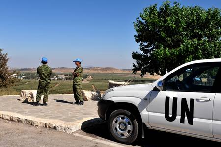 tyr: UNDOF soldiers examine the Israeli - Syrian border in the Golan Heights, Israel.