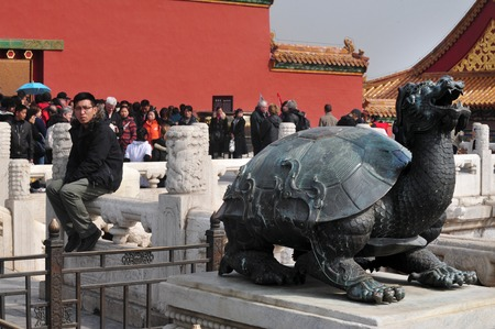 ancient relics: BEIJING - MARCH 11:Visitors at the The Forbidden City on March 11 2009 in Beijing,China.The palace museum serving as a treasure house of majority of the ancient Chinese historical and cultural relics. Editorial