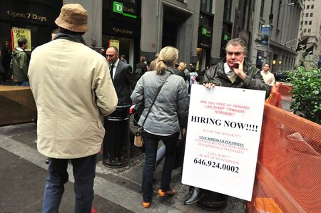 capitalization: NY - OCT 09: An  Unemployed American protest in Wall Street on October 09 2009 in Manhattan New York.It is the home of the New York Stock Exchange, the worlds largest stock exchange by market capitalization of its listed companies