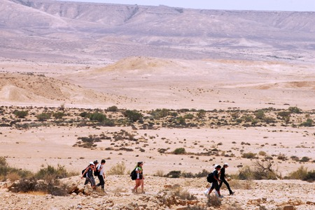 israelis: NEGEV,ISR - MAY 31:People cross the wilderness of the Negev Desert on May 31 2009.Various peoples have lived in the Negev since the dawn of history such as:Nomads, Canaanites, Nabateans and Israelis.