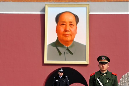worshiped: BEIJING - MARCH 11:Chinese soldier stands guard in front of a portrait of Mao Zedong in Tiananmen square on March 11 2009 in Beijing,China. Chairman Mao Zedong is still being worshiped all over China.