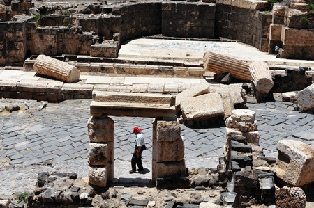 17 years: BEIT SHEAN,ISR - JUNE 17:Visitor walks near Pillars in Ancient Beit Shean on June 17 2009.Beit Shean is one of the most ancient sites in Israel: it was first settled 5-6 thousand years ago.