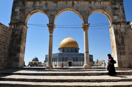 disputed: JERUSALEM - JULY 30:Muslim woman visit the Golden Dome Mosque on July 30 2009 in Jerusalem, Israel.Its the most disputed holy ground between Muslims and Jewish people. Editorial