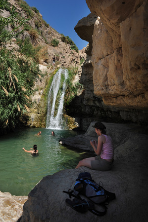 gedi: EIN GEDI, ISR - JUNE 07  :Visitors swim in Ein Gedi spring on June 07 2009. Its a very famous and popular  oasis on the shore of Israels Dead Sea, the lowest place on Earth.