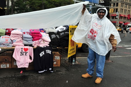 imitations: NY - OCT 09:Afro American man sale - I LOVE NY shirts on October 09 2010 in Manhattan New York. The logo has become a pop-culture icon, inspiring imitations in every corner of the globe