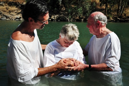 holyland: TIBERIAS - MAY 18:Christian pilgrims during mass baptism ceremony at the Jordan River in North Israel on May 18 2009.In Christian tradition, Jesus was baptised in the River Jordan by John the Baptist. Editorial