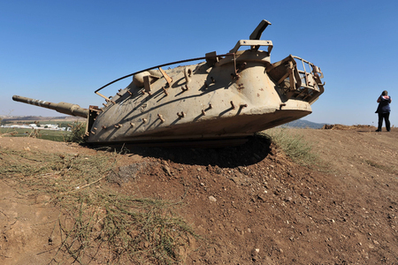regain: GOLAN HEIGHTS - AUG 23:A destroyed Syrian tank on August 23 2009 in G.H Israel. Syria tried to regain the plateau in 1973 war but failed since 1974 armistice the Golan has been relatively quiet. Editorial