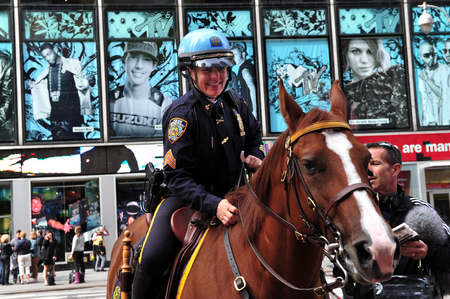 entertainment industry: NY - OCT 08:American policewoman on a police horse  on October 08 2010 in Manhattan New York, USA.Its a major center of the worlds entertainment industry. Editorial