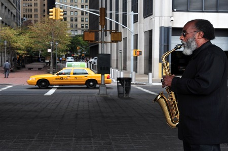 origin of man: NY - OCT 09: Black American saxophone player play Jazz on October 09 2009 in Manhattan New York.Its the most significant form of musical expression of African-American culture
