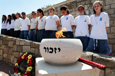 israelis: SDEROT - APRIL 28: Israeli children and soldiers are participating in a memorial ceremony on April 28 2009 in Sderot, Israel. The day commemorates the deaths of thousands of Israelis at the hands of terrorists following with the Israel Independence day.