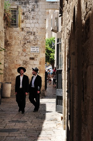 synagogues: JERUSALEM - JULY 28:Orthodox Jewish men at the Jewish quarter on July 28 2009 Jerusalem,Israel.The quarter is inhabited by around 2,000 residents and is home to numerous yeshivas and synagogues. Editorial