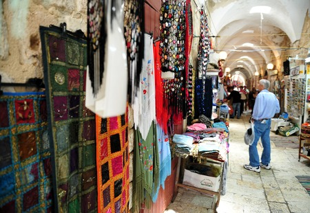 continuously: ACRE, ISR - MAY 13:Visitors by goods in the old market of Acre on May 13 2009.Acre is one of the oldest continuously inhabited sites in Israel.