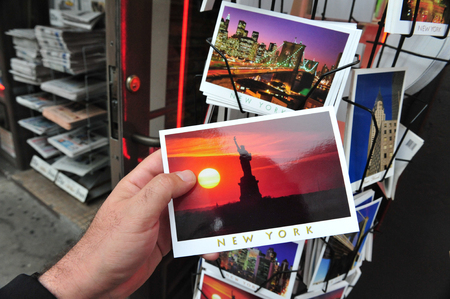 memento: NY - OCT 09: Postcards Stand with a post card of the Statue of Liberty on October 09 2009 in Manhattan New York. Libertas is the ancient Roman goddess of freedom. Editorial