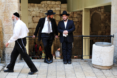 jewish home: JERUSALEM - JULY 28:Orthodox Jewish men at the Jewish quarter on July 28 2009 Jerusalem,Israel.The quarter is inhabited by around 2,000 residents and is home to numerous yeshivas and synagogues. Editorial