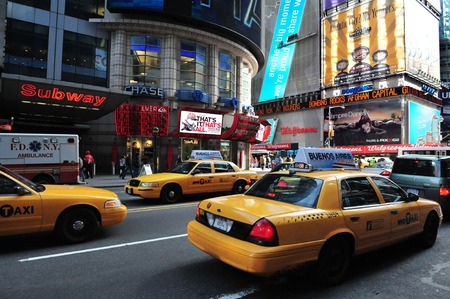 taxicabs: NY - OCT 08: Traffic on Time Square on October 08 2010 in Manhattan New York, USA.Its a major center of the worlds entertainment industry. Editorial