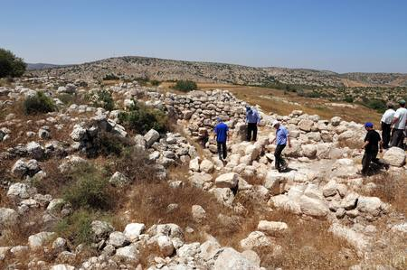 judaean: AMATZIA, ISR - AUG 02:Visitors on ruins at Amatzia Caves near Kiryat Gat on August 02 2009.During troubled times, the Jews of ancient Israel often dwelled in artificial limestone underground caves.