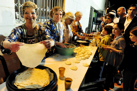kiddush: SDEROT - APRIL 27:Jewish people celebrats the traditional North African Jewish celebration Mimouna held the day after the Jewish holiday of Passover on April 27 2008 in Jerusalem, Israel. It marks the start of spring and the return to eat leavened bread a Editorial