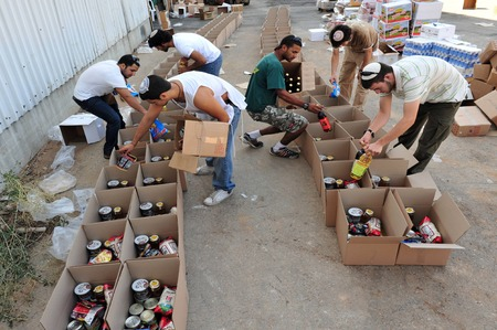 SDEROT - SEPTEMBER 15:Israeli youth are giving food to poor Jewish families during the jewish holidays on September 15 2009 in Sderot,Israel.