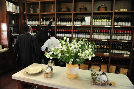 totaled: ZIKHRON,ISR - AUG 07:People buy wine from local winery on Aug 07 2009.Wine has been produced in the Land of Israel since biblical times. In 2011, Israeli wine exports totaled over $26.7 million. Editorial