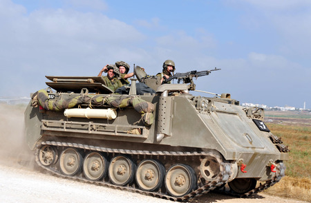 retained: NACHAL OZ, ISR - JUNE 07:Israeli fighters on M113 armored personnel carrieron in North Gaza strip on June 07 2008.Under its disengagement plan in 2005,Israel retained exclusive control over Gaza strip Editorial