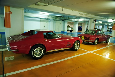 people only: TEL AVIV - MAY 13:A classic red 1973 Corvette Stingray Coupe parked in a parking lot on May 13 2009 in Tel Aviv,Israel.In Israel there is 4,000 registered collectible vehicles belong to 850 people only. Editorial