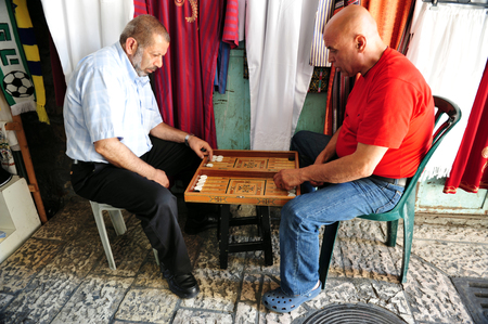 JERUSALEM - JULY 30: An old arab men playing backgammon on July 30 2009 inJerusalem, Israel.Its one of the oldest board games for two players in the world.