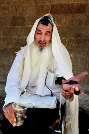 mishnah: JERUSALEM - JULY 30: An old Jewish orthodox man begging for tzedakah in the street on July 30 2009 in Jerusalem, Israel. Unlike philanthropy or charity, tzedakah is seen as a religious obligation, which must be performed regardless of financial standing,