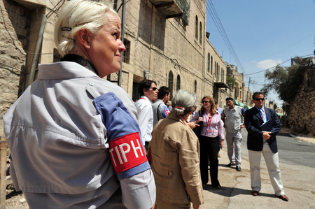 observers: HEBRON, ISRAEL - SEP 08:TIPH observers patrols in Hebron on September 09 2009.It established in 1994 after the Cave of the Patriarchs massacre in which 29 Palestinians were killed by Baruch Goldstein Editorial