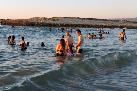 i t: ZICHRON YAAKOV, ISR - AUG 07: Visitors at sanctuary Dor Habonim beach on Au 07 2009. Its one of the top 10 most beautiful beaches in Israel!.