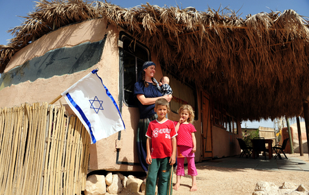 pioneers: NEGEV, ISR - APR 07:Israeli family live in a Mud Bus on April 07 2011.The Negev covers more than half of Israel, over some 13,000 km² (4,700 sq mi) or at least 55% of the countrys land area. Editorial
