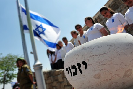 SDEROT - APRIL 28: Israeli children and soldiers are participating in a memorial ceremony on April 28 2009 in Sderot, Israel. The day commemorates the deaths of thousands of Israelis at the hands of terrorists following with the Israel Independence day.