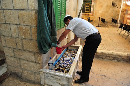 jewish people: HEBRON, ISRAEL - SEP 08:Jewish man pray at the Cave of the Patriarchs in Hebron on September 09 2009.According to tradition all the Patriarchs and Matriarchs of the Jewish people believed to be buried there.