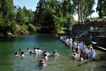 baptism of jesus: TIBERIAS - MAY 18:Christian pilgrims during mass baptism ceremony at the Jordan River in North Israel on May 18 2009.In Christian tradition, Jesus was baptised in the River Jordan by John the Baptist. Editorial