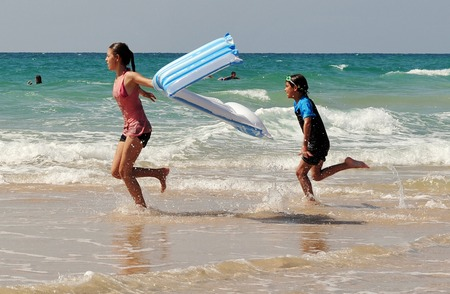 constituting: ASHDOD - JULY 19:Israeli childrens enjoys the sea on July19 2009.The population of children living in Israel numbered ABOUT of 2,500,000 children, constituting over 30% of the general population.