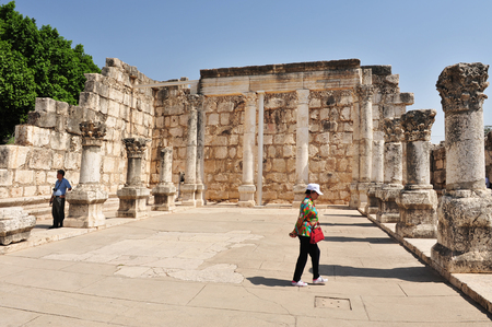 jewish home: GALILEE,ISRAEL - MAY 19:Pilgrims at the ancient synagogue in Capernaum on May 19 2009.It was a Jewish fishing village and it said to be the home of St Peter and where Jesus healed a paralytic.