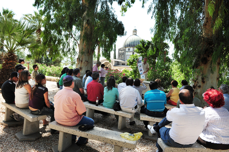 the sermon: GALILEE,ISRAEL - MAY 19:Pilgrims at the Mount of Beatitudes Roman Catholic chapel on May 19 2009.Mount of Beatitudes refers to the hill in northern Israel where Jesus delivered the Sermon on the Mount Editorial