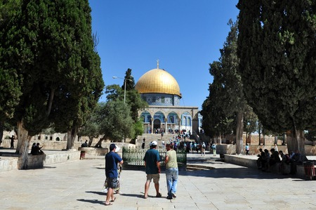 disputed: JERUSALEM - JULY 30:Visitors at the Golden Dome Mosque at Temple Mount on July 30 2009 in Jerusalem, Israel.Its the most disputed holy ground between Muslims and Jewish people. Editorial