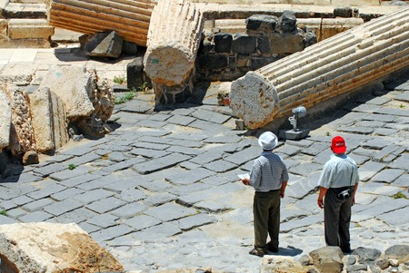 17 years: BEIT SHEAN,ISR - JUNE 17:Visitors walks under Pillars in Ancient Beit Shean on June 17 2009.Beit Shean is one of the most ancient sites in Israel: it was first settled 5-6 thousand years ago.