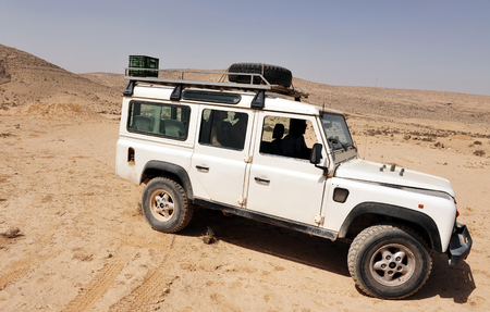 fourwheeldrive: WESTERN NEGEV - MAY 15: A 4x4 car drive in the Negev desert, Israel on May 15 2009.The first  four-wheel-drive was built and designed in 1899 by Ferdinand Porsche Editorial