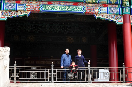 one child: BEIJING - MARCH 11:Chinese family visit in the forbidden city  on March 11 2009 in Beijing,China.When One Child Policy was adopted in 1979,Chinas population was about 972 million. Today its about 1.343 billion people.
