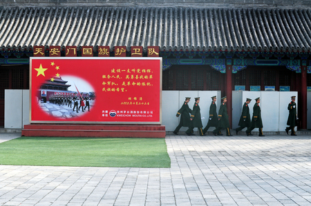 compulsory: BEIJING - MARCH 11:Chinese soldiers march inside the Forbidden City on March 11 2009 in Beijing,China.Military service in China is compulsory, in theory, for all men who attain the age of 18 Editorial