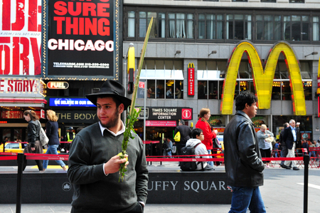 jewish community: NY - OCT 08:American Jewish man holds the four spices during sukkoth Jewish holidayin in Time Square on October 08 2010 in Manhattan New York. The US is home to the second largest after Israel Jewish community in the world. Editorial