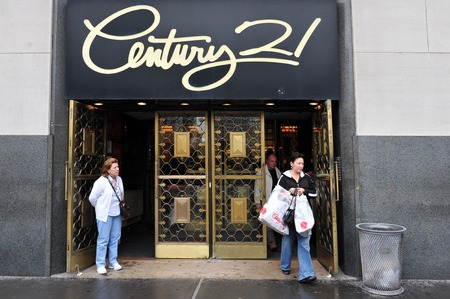 low prices: NY - OCT 09: Shoppers coming out from Century 21 store on October 09 2009 in Manhattan New York.Its a legendary New York City retailer offering top designer merchandise at low prices for over 50 years Editorial