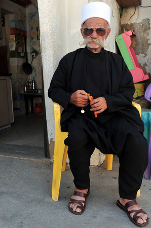MAJDAL SHAMS - AUGUST 23:A Druze man sit outside his front door in Majdal Shams,Israel on August 23 2009.The number of Druze people worldwide exceeds one million, with the vast majority residing in the Middle East.