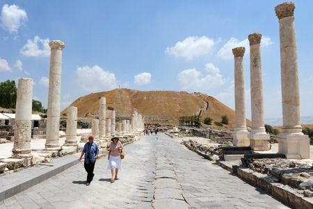 cultural artifacts: BEIT SHEAN,ISR - JUNE 17:Visitors walks under Pillars in Ancient Beit Shean on June 17 2009.Beit Shean is one of the most ancient sites in Israel: it was first settled 5-6 thousand years ago.